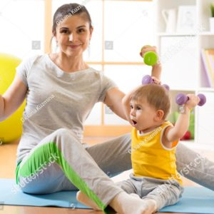 stock-photo-mother-with-little-kid-doing-gymnastics-and-fitness-exercises-606070586